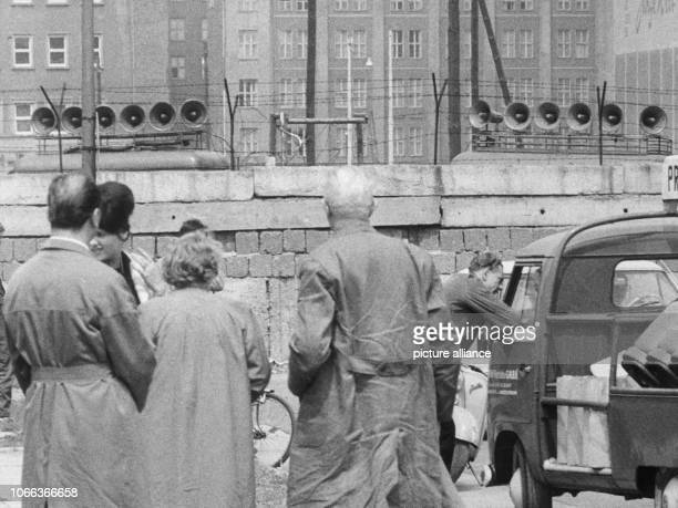 Sound trucks are deployed on East Berlin's side of the Berlin Wall near Koch street in Berlin Germany 1962 After border incidents at Berlin's sector...