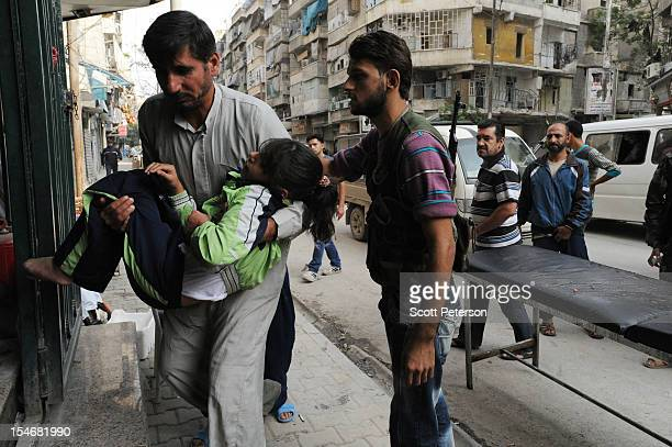 A sounded Syrian girl is brought to hospital as the intense human and material cost grows from three months of intense fighting against rebels of the...