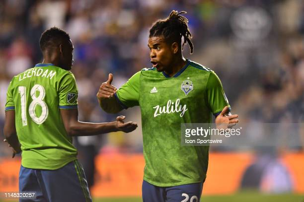 Sounders Defender Roman Torres regroups with Sounders Defender Kelvin Leerdam after a scuffle in the second half during the game between the Seattle...