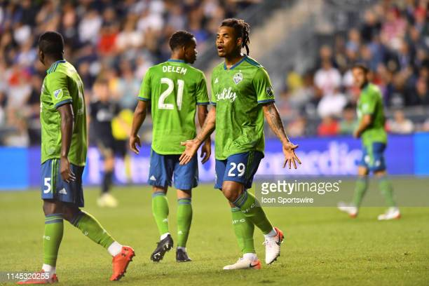 Sounders Defender Roman Torres tries to calm Defender Nouhou Tolo in the second half during the game between the Seattle Sounders and Philadelphia...