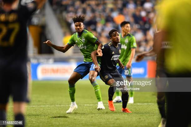 Sounders Defender Saad AbdulSalaam fights for position on a throw in with Union Forward Sergio Santos in the first half during the game between the...