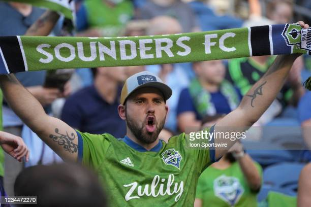 Sounders fan shows his support at the start of an MLS match between FC Dallas and the Seattle Sounders on August 4, 2021 at Lumen Field in Seattle,...
