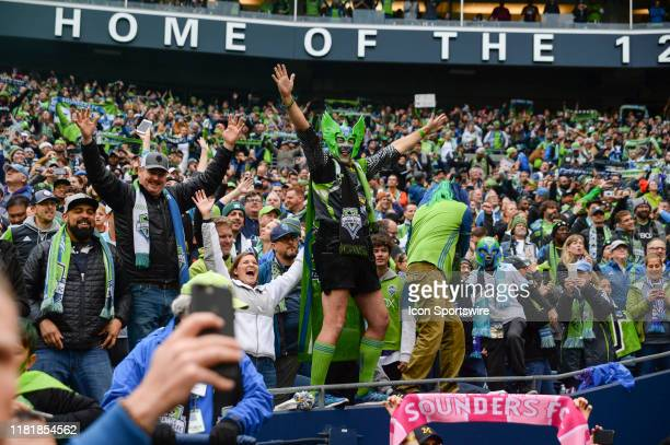 Sounders fans celebrate their MLS Cup win after the MLS Championship game between the Seattle Sounders and Toronto FC on November 10 at Century Link...