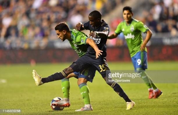 Sounders Midfielder Alex Roldan shields the ball from Union Midfielder Jamiro Monteiro in the second half during the game between the Seattle...
