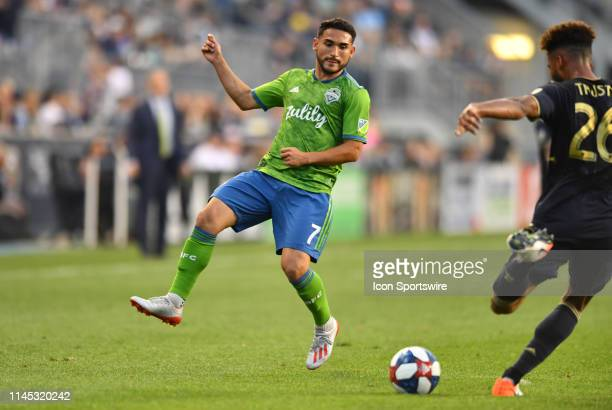 Sounders Midfielder Cristian Roldan attempts to block a clearance from Union Defender Auston Trusty in the first half during the game between the...