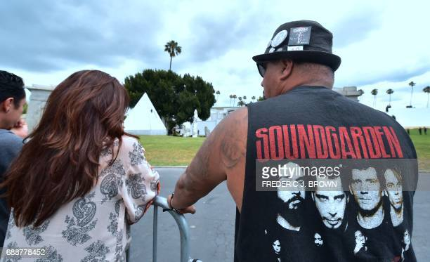 Soundgarden fan Richard Corral wears the band's tshirt while attending the funeral service of Soundgarden frontman Chris Cornell on May 26 2017 at...
