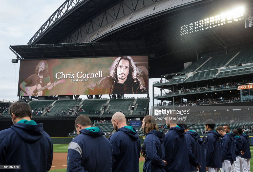 Soundgarden vocalist and guitarist Chris Cornell is pictured on the scoreboard during a moment of silence before a game between the Chicago White Sox and the Seattle Mariners at Safeco Field on May 18, 2017 in Seattle, Washington. Cornell was found dead in his hotel room in Detroit where he was on tour with Soundgarden. Police say they are investigating the death as a possible suicide.
