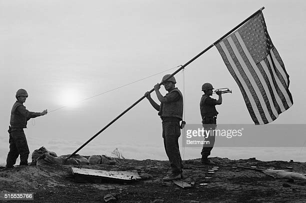 Sounding Colors Hill 881 South Vietnam With a Marine bugler sounding colors at the morning's first light a US flag is hoisted atop a 15 foot radio...