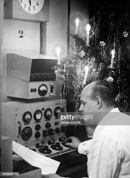 Soundman is working on Christmas Photographer Curt Ullmann Published by 'Hier Berlin' 51/1938Vintage property of ullstein bild