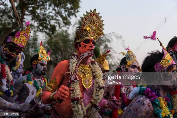 A soung of gajan is performing while the other soungs are watching his acts in Burdwan India on 13 April 2017 quotGajanquot is one of the prominent...