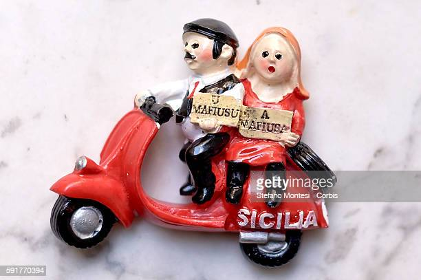 Sounvenirs sold in stores which depict 'U mafiusu Sicily' on vespa with the traditional Sicilian headgear the coppola on August 12 2016 in Palermo...