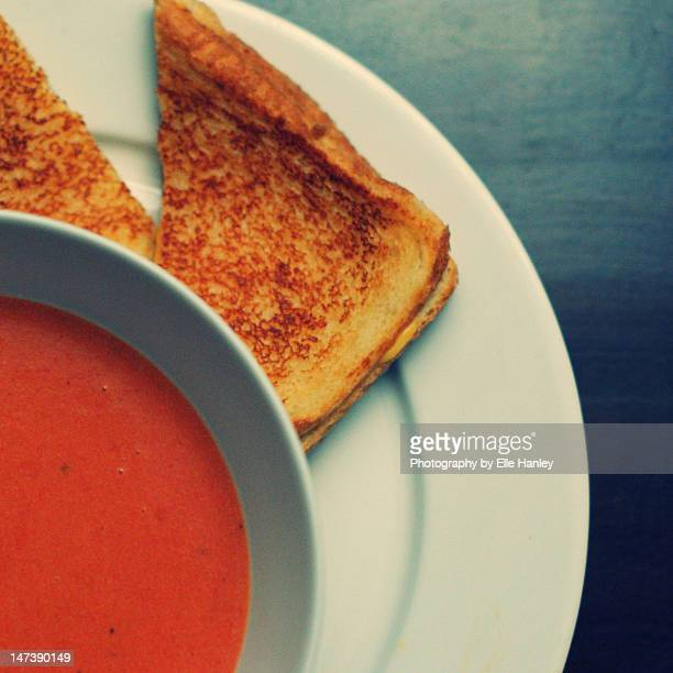 soup and  grilled cheese sandwich - tomato soup stock photos and pictures