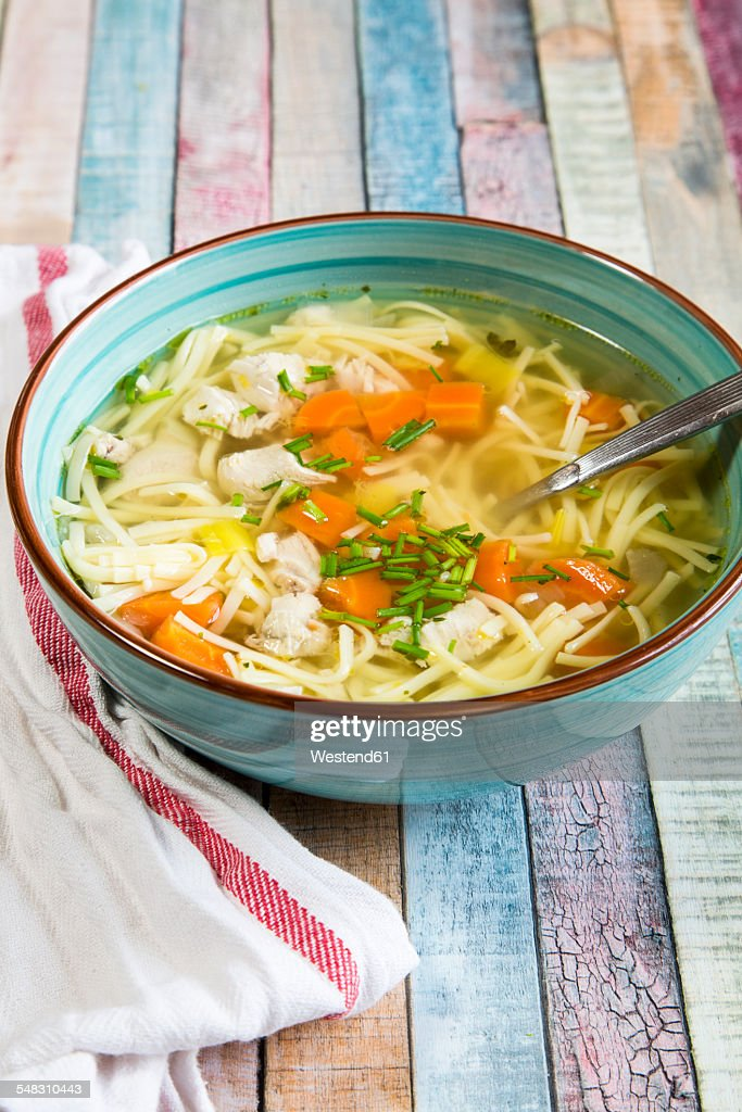 Soup bowl of chicken stock with noodles, carrots and chive : Stock Photo