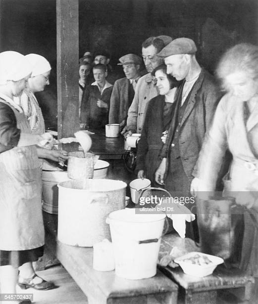 A soup kitchen that is being organized by unemployed and their relatives Each person gets one liter stew per meal 1931Vintage property of ullstein...
