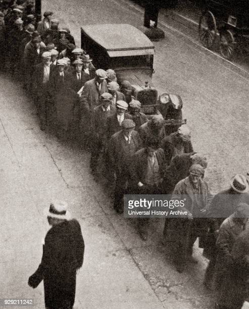 A soup line at The Bowery Mission Manhattan New York City United States of America during the great depression From The Literary Digest published 1930