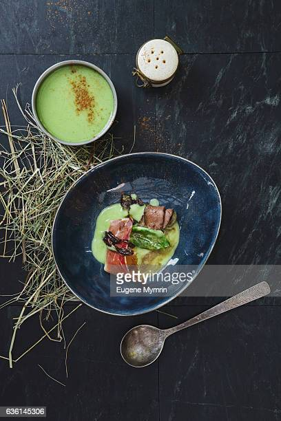 Soup with spinach, prosciutto and venison