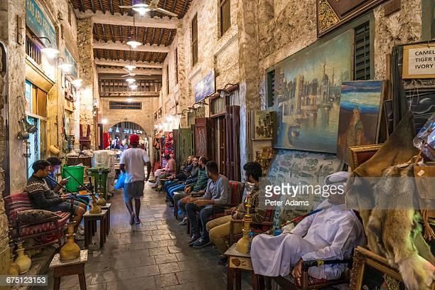 souq waqif with sheesha smokers, doha, qatar - shisha bar stock-fotos und bilder