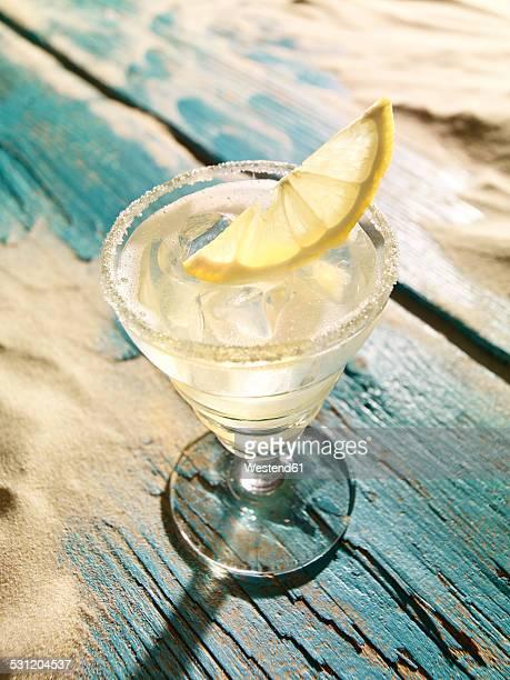 Sour cocktail with lemon slice