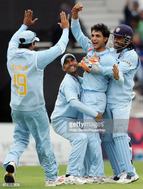 Sourav Ganguly is congratulated by Rahul Dravid Dinesh Karthik and Mahendra Singh Dhoni after getting the wicket of Ian Bell during the 5th one day...
