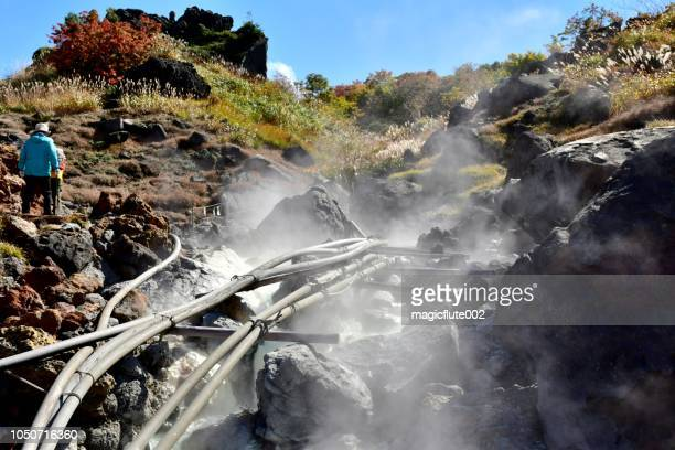 source of hot spring water at sugawa plateau, mt kurikoma - iwate prefecture stock photos and pictures