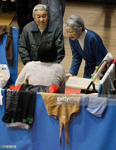 SOURCEJapan's Emperor Akihito and Empress Michiko talk with an evacuee from the March 11 earthquake and tsunami at Tokyo Budohkan acting as an...