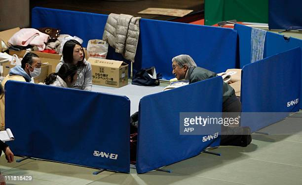 SOURCEJapan's Emperor Akihito talks with evacuees from the March 11 earthquake and tsunami at Tokyo Budohkan acting as an evacuation shelter in Tokyo...