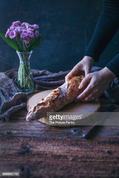 Sourdough baguette on a rustic wooden table