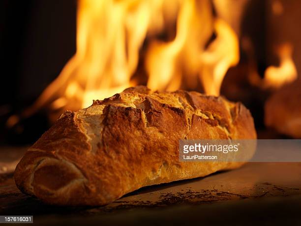 sourdough bread in a wood burning oven - wood burning stove stock photos and pictures