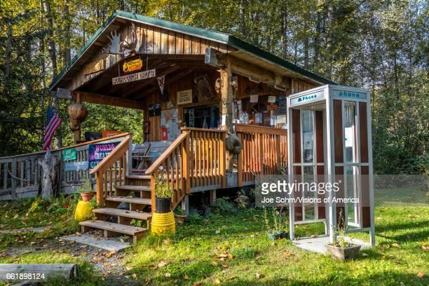 Sourdough Drus Alaskan cabin with telephone booth Hope Alaska Americana and kitsch