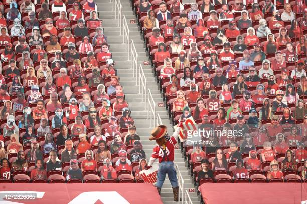 Sourdough Sam, the San Francisco 49ers mascot, tries to get the cardboard cutout fans to cheer during their game against the Arizona Cardinals at...