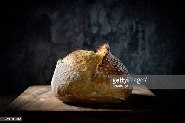 sourdough with dark background - loaf of bread stock pictures, royalty-free photos & images