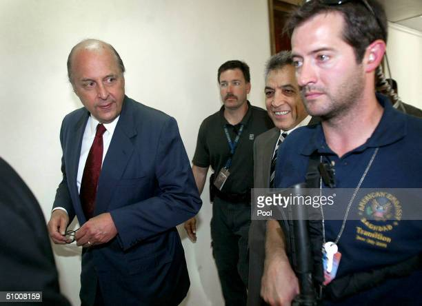 Sourrounded by security US Ambassador John Negroponte leaves after presenting his credentials to Iraqi President Ghazi alYawer and Iraqi Foreign...