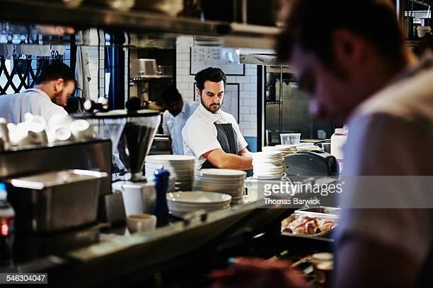Sous chef in restaurant preparing for dinner