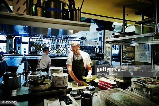 Sous chef preparing ingredients in kitchen