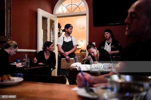 Sous chefs Ben Ashworth and Becka Bogue update front house staff about the evening specials and other kitchen happenings before evening service at...