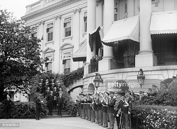 Sousa's Marine Band plays Stars and Stripes Forever on the White House steps for President Hoover and Sir Ronald Linsaym a British ambassador in this...