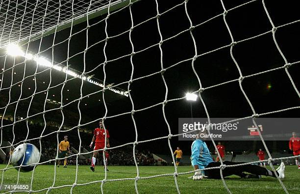 Soush Makani goalkeeper of Iran can only watch as he is beaten by a shot from James Troisi of Australia during the Olympic Games qualifying match...