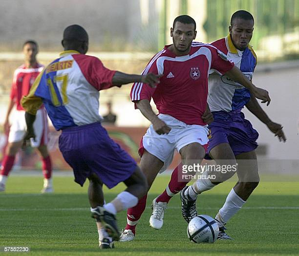 Tunisian Etoile du Sahel's Yassine Hikhaoui vies with Ghanian Accra Hearts of Oak's Charles Vardis and Mickael Donker in an African Champions League...