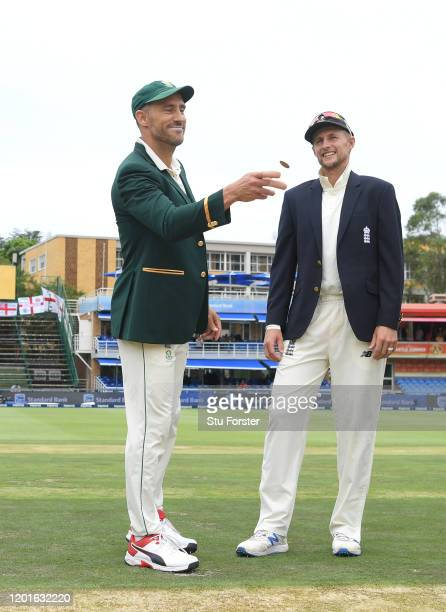 South Aafrica captain Faf du Plessis tosses the coin watched by Joe Root during Day One of the Fourth Test between South Africa and England at The...
