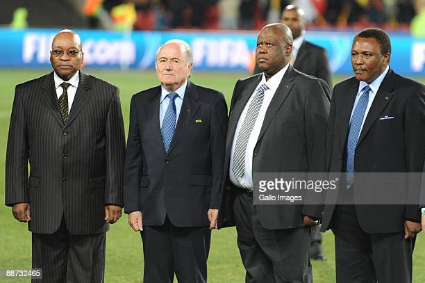 South Afrcian President Jacob Zuma Sepp Blatter Molife Oliphant and Irvin Khoza stand on the pitch during the 2009 Confederations Cup final match...