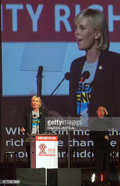 South Africa actress Charlize Theron speaks on stage during the official opening of the 21st International AIDS conference at the International...