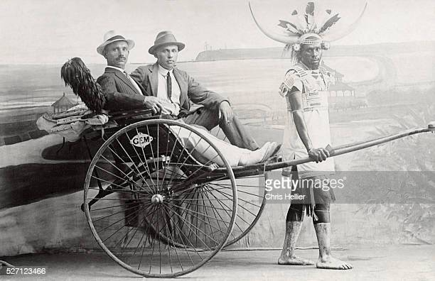 South Africa Apartheid A Couple of White Men Ride on Rickshaw Pulled by a Black African Studio Photograoh Durban c1940
