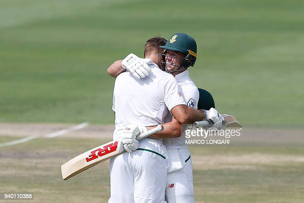 South Africa batsman AB de Villiers congratulates South Africa batsman Aiden Markram after he scored a century on the first day of the fourth Test...
