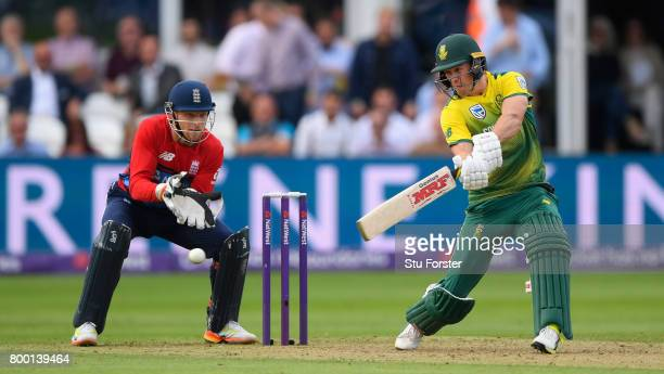 South Africa batsman AB de Villiers hits out watched by Jos Buttler during the 2nd NatWest T20 International between England and South Africa at The...