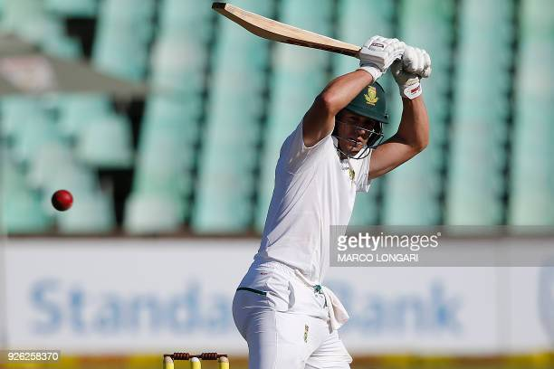 South Africa batsman AB de Villiers hits the ball during day two of the first Test cricket match between South Africa and Australia at the Kingsmead...