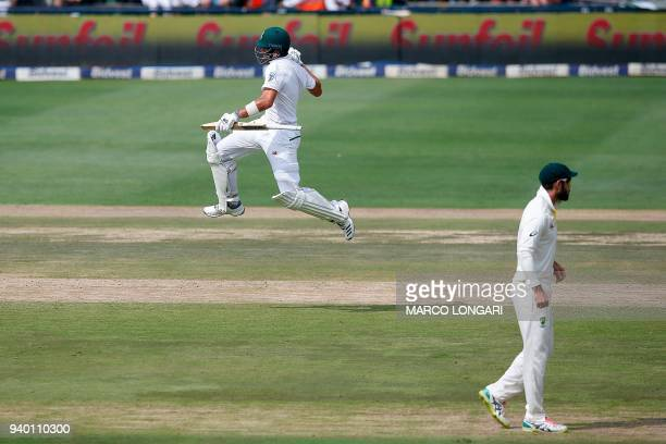 South Africa batsman Aiden Markram leaps in the air and celebrates scoring a century on the first day of the fourth Test cricket match between South...