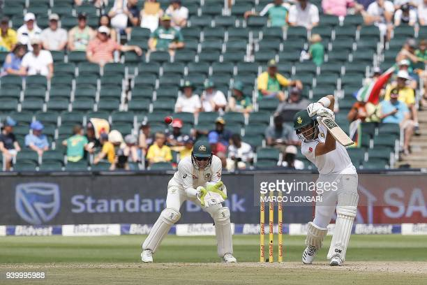 South Africa batsman Aiden Markram plays a shot as Australia wicketkeeper and captain Tim Paine waits to receive during the first day of the fourth...