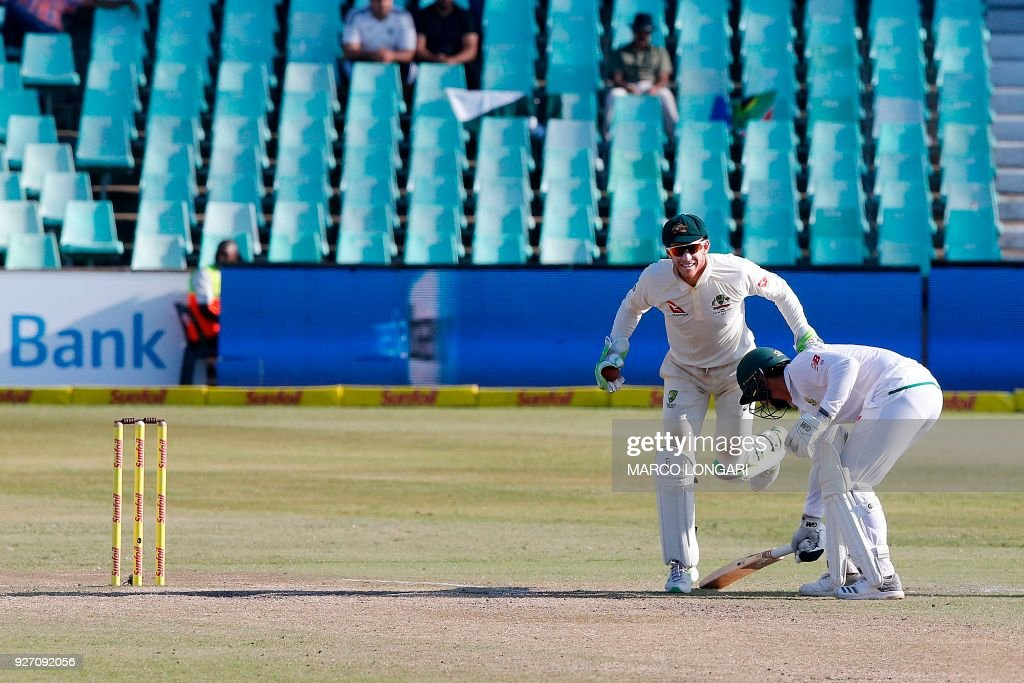 South Africa batsman Aiden Markram safely makes his ground as Australia wicketkeeper stumbles on him during the fourth day of the first Test cricket match between South Africa and Australia at The Kingsmead Stadium in Durban on March 4, 2018. /