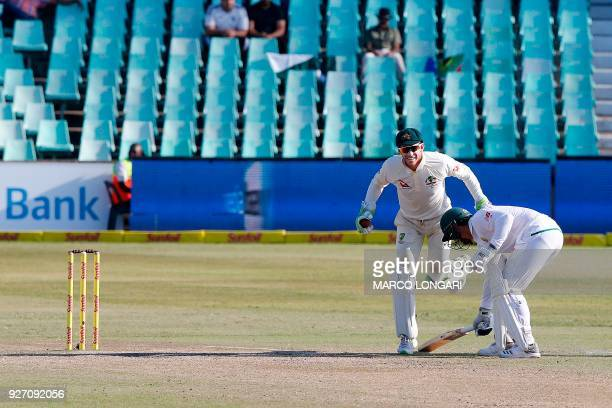 South Africa batsman Aiden Markram safely makes his ground as Australia wicketkeeper stumbles on him during the fourth day of the first Test cricket...