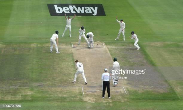 South Africa batsman Anrich Nortje is bowled by Dom Bess as the close in fielders celebrate during Day Five of the Third Test between South Africa...